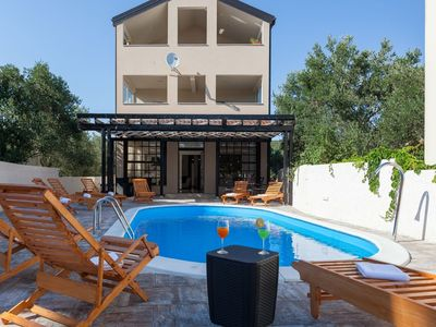 Photo for Beautiful villa with private pool, 7 en suite bedrooms, 3 roofed terraces, BBQ