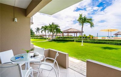 Photo for Relax and recharge in this 3-bedroom, oceanfront condo just steps from Seven Mile Beach