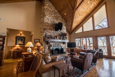 Living room with gas log fireplace, TV and plenty of seating