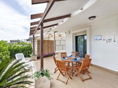 Photo for 3 bedroom Villa, sleeps 6 with Air Con and Walk to Beach & Shops