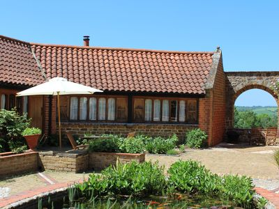 Photo for The cosiest and quaintest haven for couples, near Great Tew