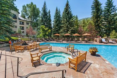 The outdoor pool, hot tub, and fire pit are a few of the fantastic amenities of The Charter complex.