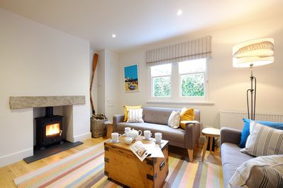 Open plan living: sitting area with woodburner