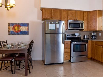 Photo for Two bedroom, two bathroom riverside condo with gas fireplace, sofa sleeper and fully equipped kitche