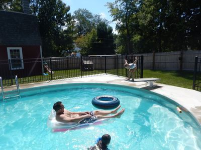 Private 9ft deep pool with diving board and a safety step around the perimeter!