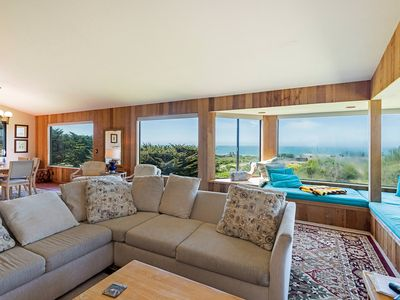 Photo for Enchanting meadow location ocean view house with secluded deck   Iris Cottage