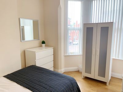 Master bedroom- wardrobe with hangers, mirror, central heating