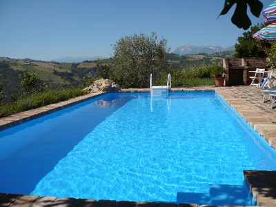 Photo for Stylish flat in a quiet dream location with own pool, garden and rooftop terrace