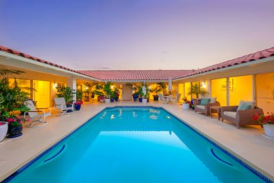 Easy access crystal clear pool in the center courtyard makes taking a spontaneous dip super easy.