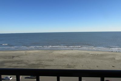 Photo from the balcony looking straight ahead to the large/wide beach ahead