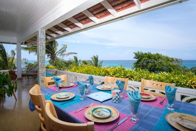 Large porch overlooking the beautiful ocean of Silver Sands with outside table