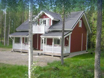 Photo for Holiday house with sauna at the lake an a private beach