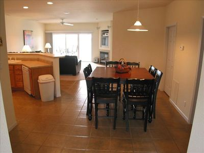 Kitchen and dining area; table for eight and breakfast bar for four