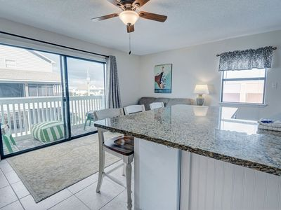 Photo for 5 min walk to the HANGOUT! Sleeps 8! Newly Remodeled! Gentle Winds! Location!