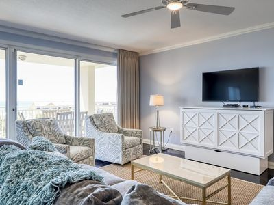 Photo for Contemporary condo near the beach! Shared pool, gym & theater for guests!