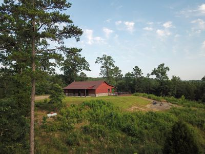 Hilltop cabin set on 3 acres with large covered porches