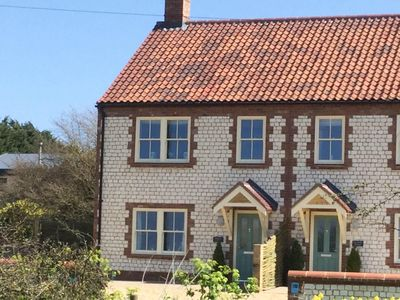 Photo for Wigeon Cottage enjoys far reaching views across the marshes
