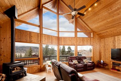 Main Living Area With 65-Inch TV, Surround Sound, Wood Stove & Leather Couches