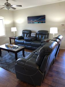 New, modern power recliner love seat and couch