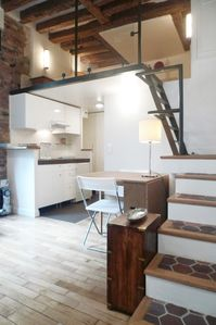 Stairs leading to the mezzanine over the open kitchen