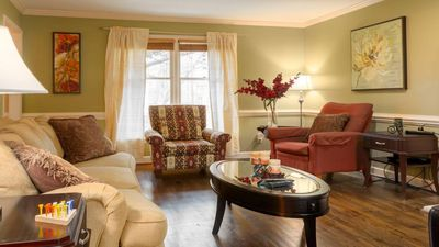 Spacious living room with comfortable seating for all guests.