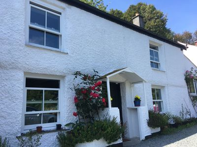 Photo for 1700s cob cottage - private parking. 1 min walk to dog friendly beach/tavern