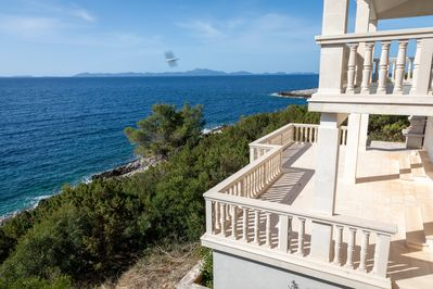 View of lower and upper apartment balconies of Adriatic Sea, island of Lastovo