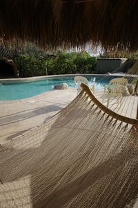 Enjoy the relaxing hammock after a quick dip in the pool