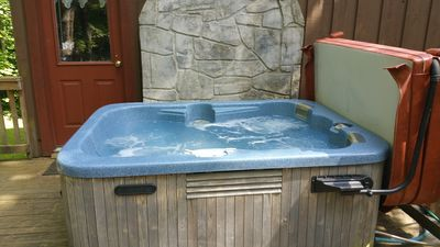Hot tub  with easy open cover