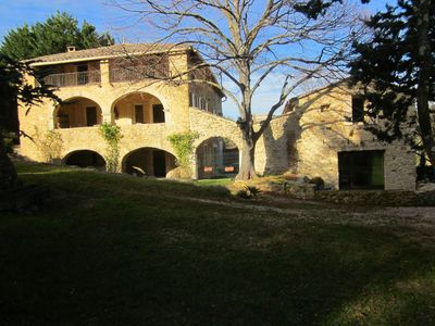 Photo for Beautiful stone cottage with jacuzzi, swimming pool and large wooded grounds.