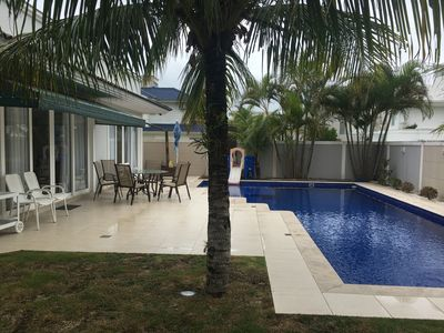Photo for Villa with 4 suites, Swimming pool and barbecue at 50 m from Jurerê Internacional Sea