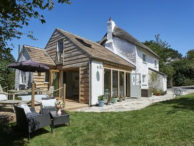 Photo for Thatched Coastal Cottage