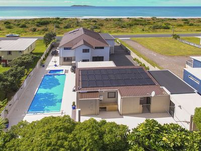 Photo for Self contained 2 bedroom beach front cottage. Waihi Beach Paradise Resort.