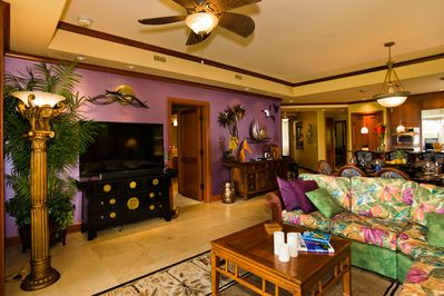 """60"""" HDTV, comfy furnishings, and unique artwork and colors to relax!"""