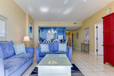 """Tides 804 Living Room -  At it's """"A Shore Thing"""", you are sure to fall in love with the endless blue and green emerald waters crashing at your doorstep."""