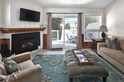 Living room with walkout to deck
