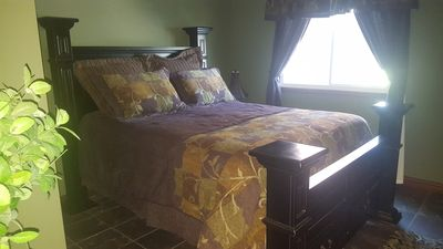 Bedroom with Queen. Located on the main level. 4 bedrooms plus a sofa sleeper.