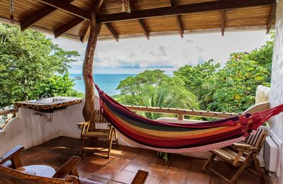 Stunning views, ocean breezes, and a beer fridge. Hammock included!