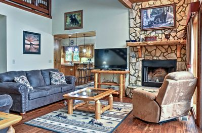 You'll love the rustic touches, including a cozy gas fireplace and alpine decor.