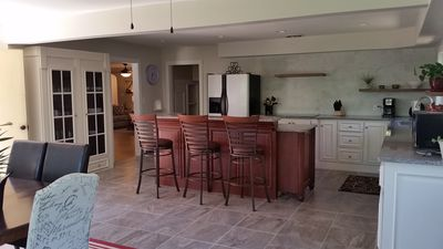 Chef style kitchen, stainless appliances, smooth cook top, granite countertops