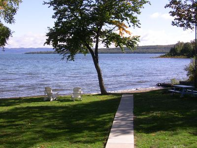 Lakeside showing sandy beach adirondack chairs