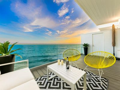 Photo for 20% OFF MAY - Endless Ocean Views w/ Luxury Living + Patio Above the Water