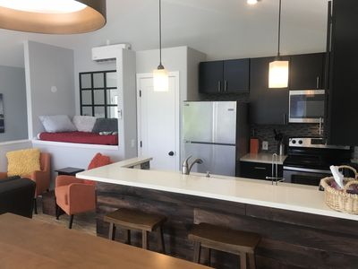 Well-appointed kitchen adjacent to cozy sitting area