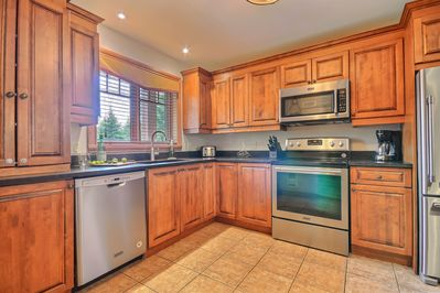 Our kitchen boasts high end stainless steel appliances and granite countertops.