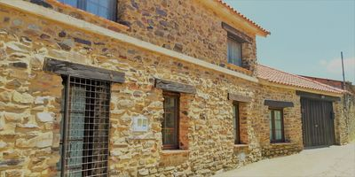 Photo for Spectacular rural house in Guadapero with heated pool, garden and fireplace.