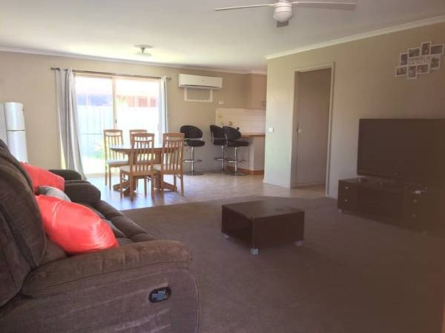 12pm checkout, family friendly, pets welcome, 2 min drive or 15min walk to town.