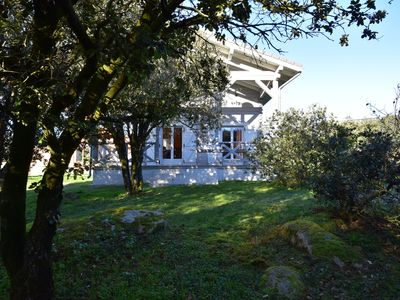 Photo for Large wooden chalet with garden and terrace at the foot of the Montagne Noire