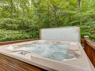 Photo for Dog-friendly woodland cabin w/ hot tub, firepit, screened porch & fireplace!