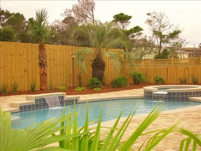 Fabulous landscaped private pool area with over 2400 feet of cobblestone pavers
