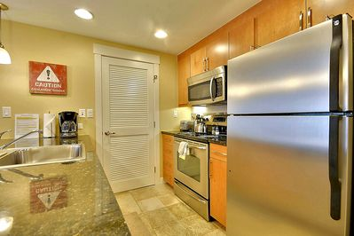 Full size refrigerator, Oven, Stovetop and Stainless Steel appliances